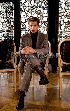 businessman sits portrait