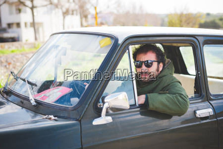 portrait of mid adult man driving
