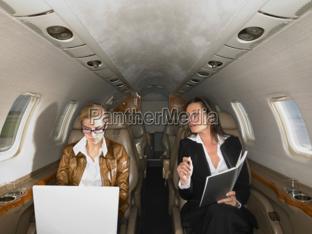 two women in private jet having