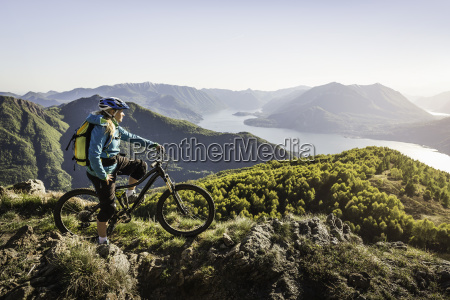young woman on mountain bike looking