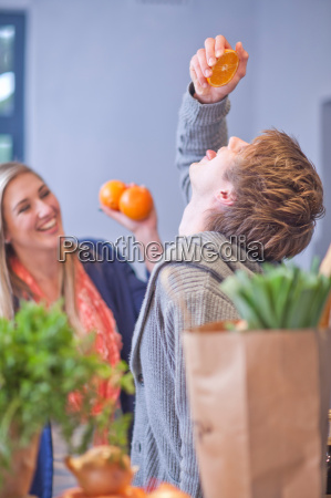 young couple messing around in kitchen