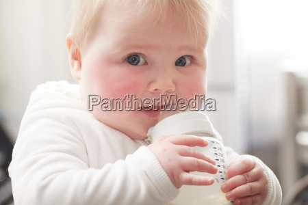baby girl drinking baby bottle