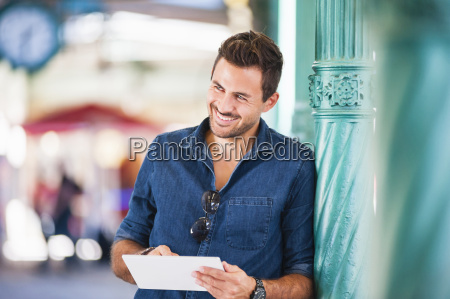 handsome young man using digital tablet