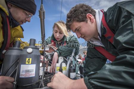 scientists assembling sea water sampling experiment