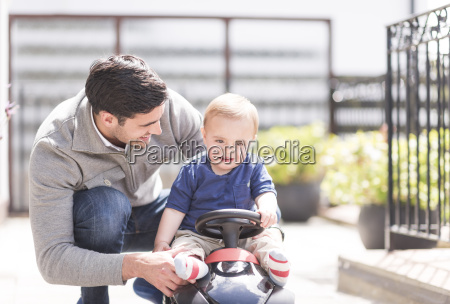 father and and young son playing