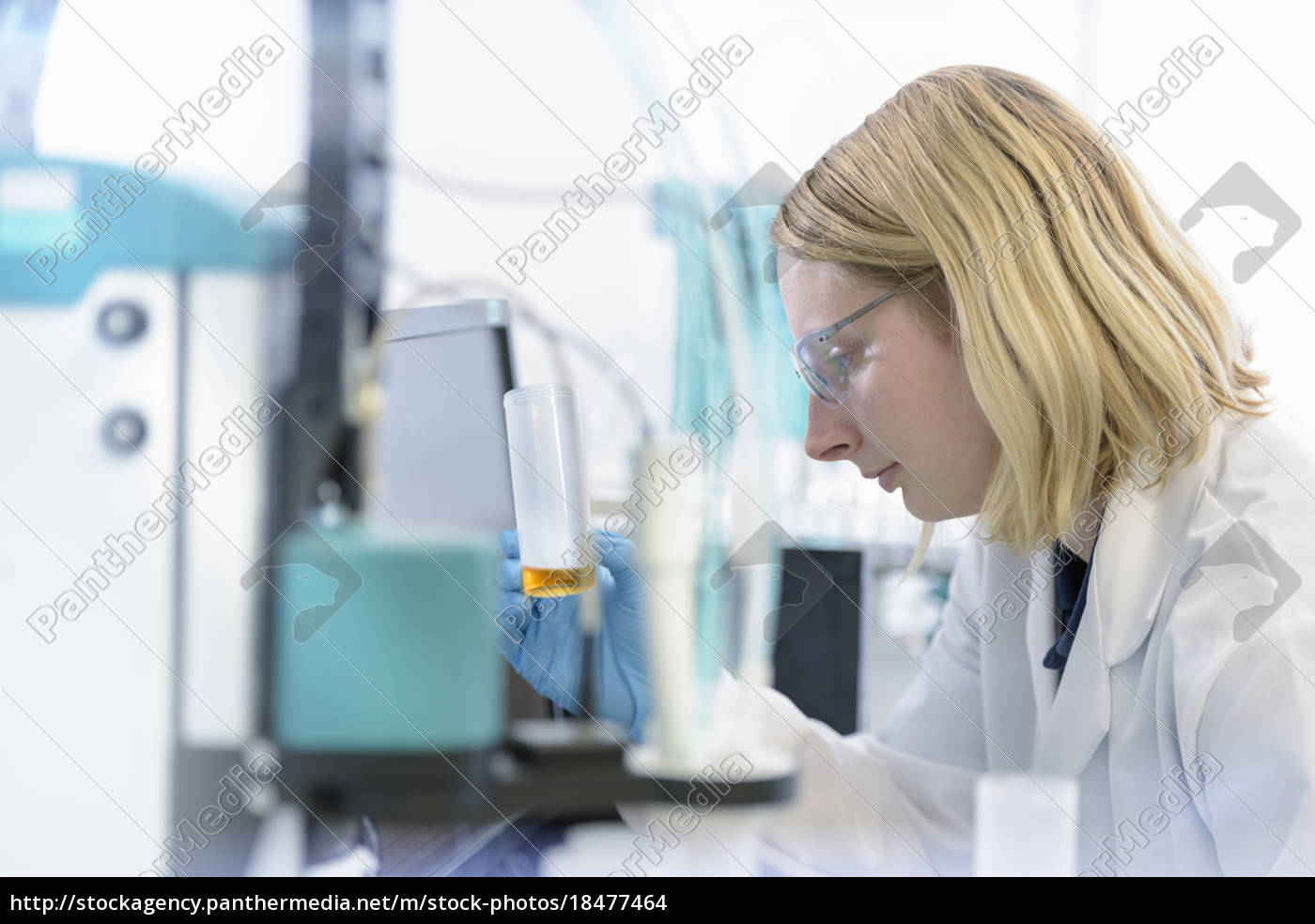 female, scientist, with, oil, sample, in - 18477464