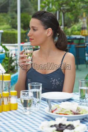young woman drinking outside