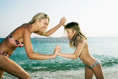 woman and young girl being playful