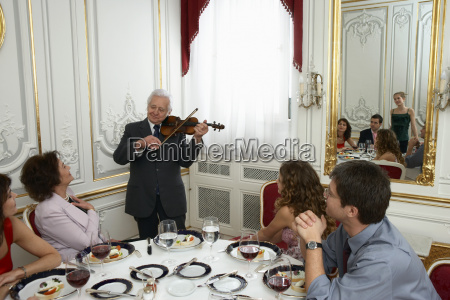 senior adult man playing violin