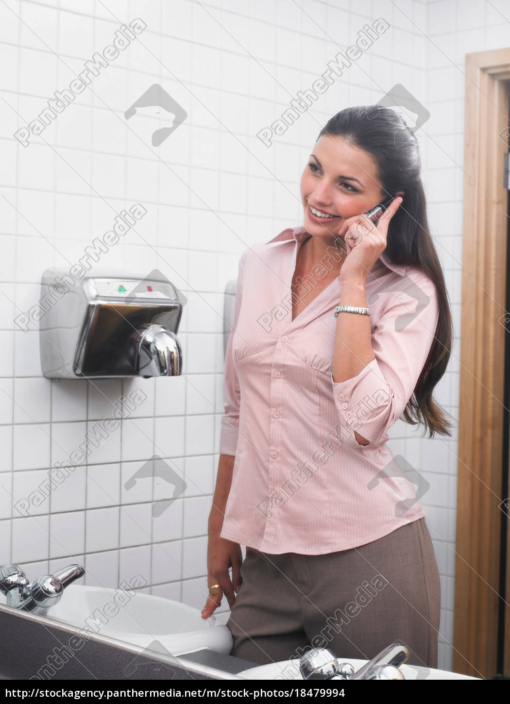 woman, reflected, in, office, washroom, mirror - 18479994