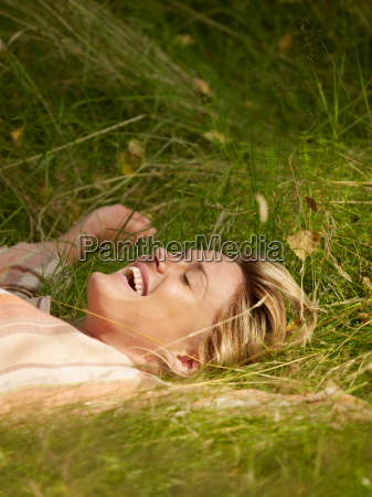 woman lying in the grass with