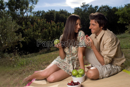 young couple sharing fresh fruit