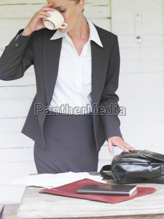 businesswoman by country cottage