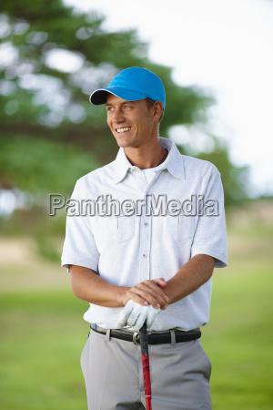 golfer wearing golf glove and baseball