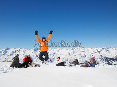 man jumping in snow