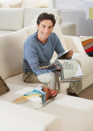man sitting on sofa in furniture