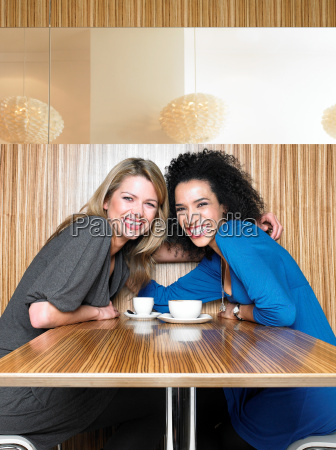 two young adult women in restaurant