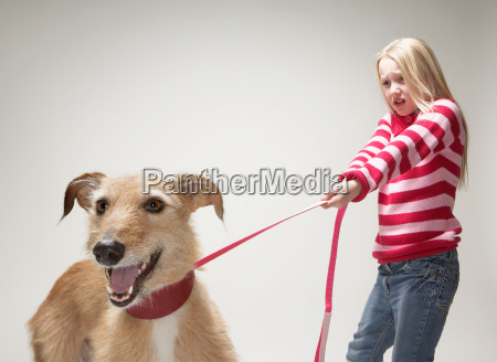 girl pulling a lurcher on lead