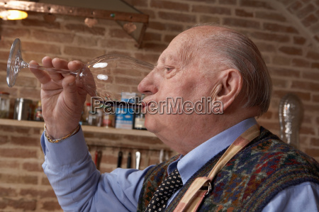 senior adult man drinking red wine