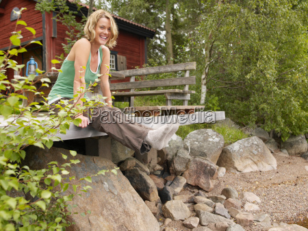 woman sitting on dock smiling