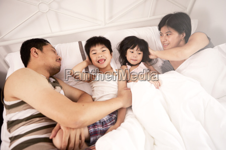 young chinese family of parents and