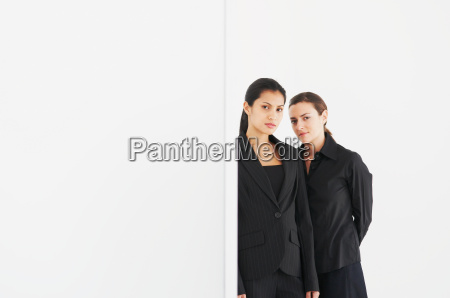 two women in black look at
