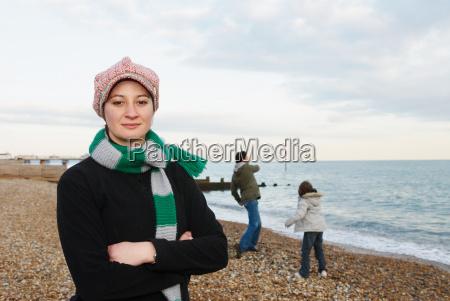 woman on beach looks to camera
