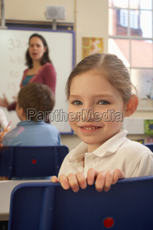 girl looking at camera in classroom