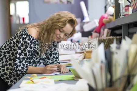 female print designer drawing designs at
