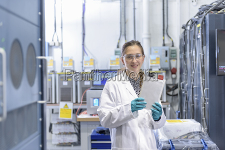portrait of female scientist holding lithium