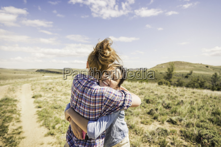 two young women hugging each other
