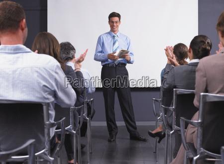 man giving speech in presentation room