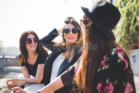 three stylish young female friends at
