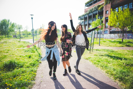 three young female friends dancing together