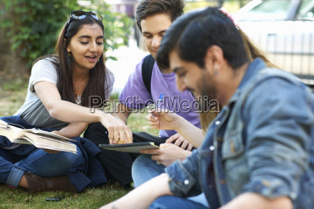 male and female students sitting chatting