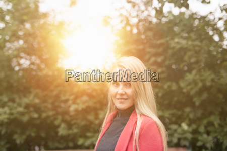 mid adult long haired blonde woman