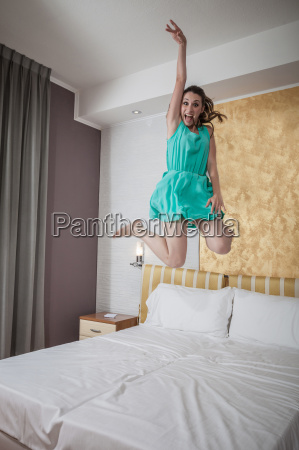 excited young woman jumping mid air