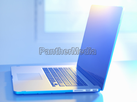 side view of open laptop on