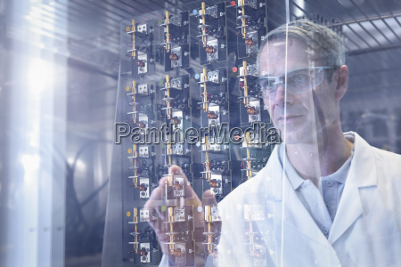 scientist inspecting test lithium ion batteries