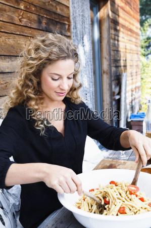 woman preparing lunch al fresco