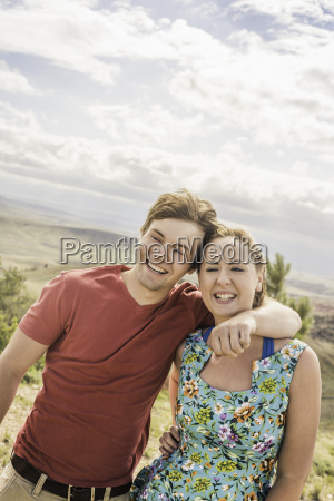 young man with arm around girlfriend
