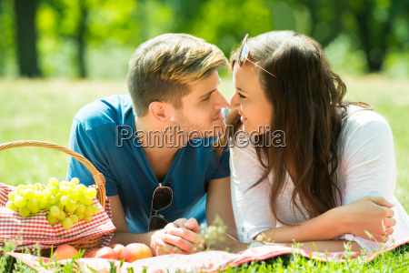 smiling young couple looking at each