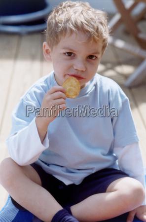 boy eating biscuit