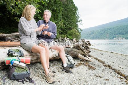 couple sitting on log