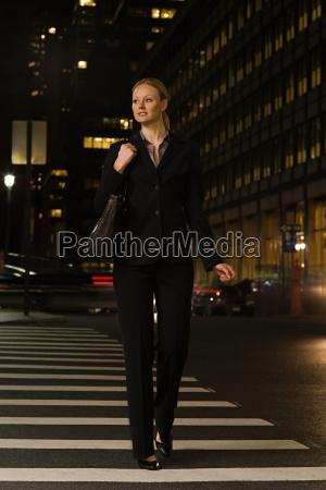 businesswoman crossing the street