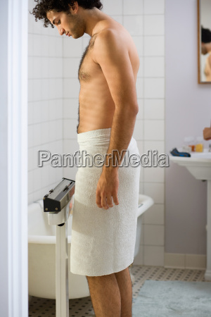 young man wearing a towel