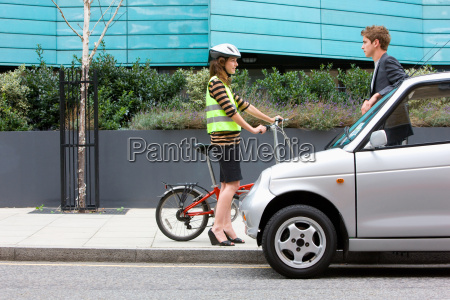 woman with bicycle and man with
