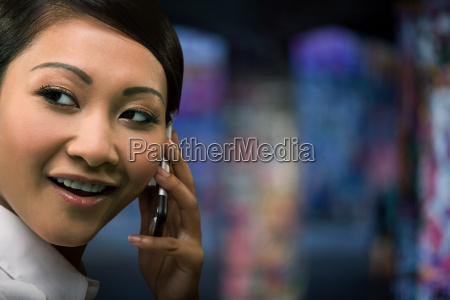 a, businesswoman, using, a, cell, phone - 18597062