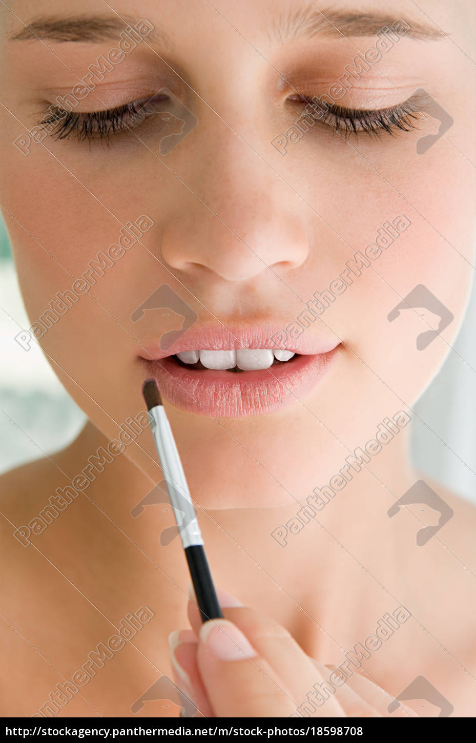 young, woman, applying, lipstick - 18598708