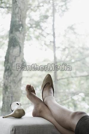 a businesswoman resting her feet